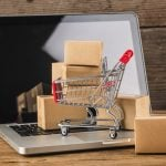 shopping-online-home-conceptcartons-shopping-cart-laptop-keyboard_1205-6174