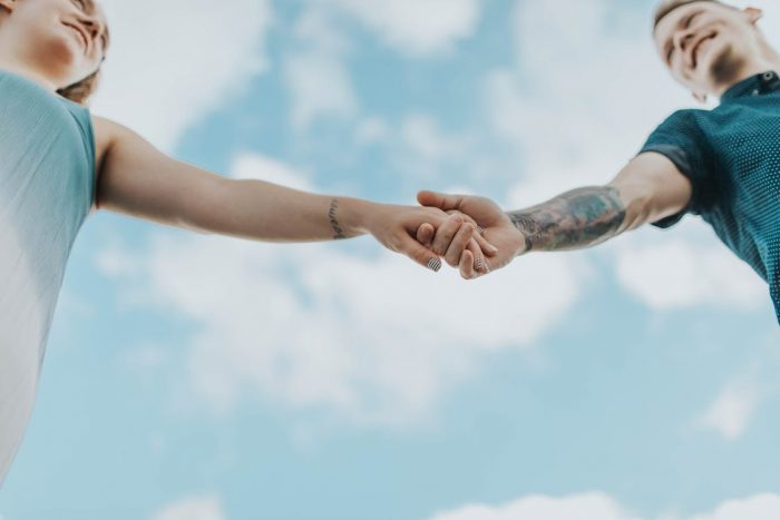 Couple Holding Each Others Hands